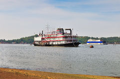 Old and modern ships on the river royalty free stock photo