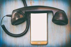 Old and modern telephone with blank screen Stock Photo