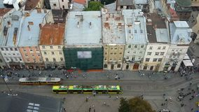 Old and modern trams moving in Lviv narrow street, past intersecting with future. Stock footage stock footage
