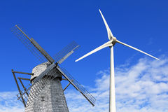 Old  and modern windmills Stock Images