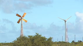 Old and modern windmills stock video footage