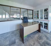 Old modern working room with a desk and cabinet royalty free stock images