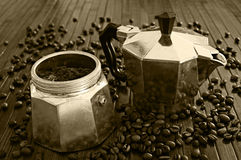Old moka with coffee. Moka pot with coffee powder and beans vintage background stock photography
