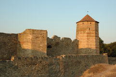 Old moldavian fortress on the river bank at sunset Royalty Free Stock Image