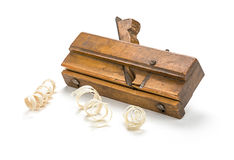 Old molding plane with shavings Royalty Free Stock Photo