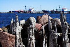 Old mole. And modern ships Royalty Free Stock Photography