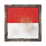 Old Monaco flag. 3d rendering of a Monaco flag over a rusty metallic plate wit a rusty frame. Isolated on white background Royalty Free Stock Images
