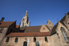 Old monastery with the cathederal and blue sky in the baclground Stock Photo