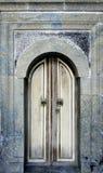 Old monastery door. Old Rila monastery door with stone frame Royalty Free Stock Photo