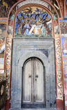 Old monastery door bible murals Royalty Free Stock Photography