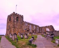 An old monastery with a graveyard in front. An old monastery with the graveyard in front royalty free stock image