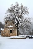 An old monastery in the snow. Old monastery in the snow in winter royalty free stock photos