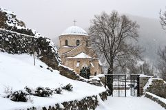 An old monastery in the snow. Old monastery in the snow in winter royalty free stock image