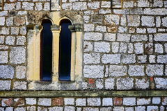 Old monastery window surrounded with stone bricks stock photography