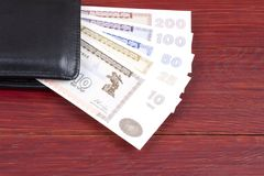 Old money from Algieria in the black wallet Royalty Free Stock Images