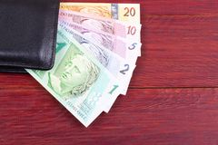 Old money from Brazil in the black wallet Royalty Free Stock Photos