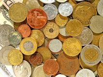 Old money coins of different countries on dollar background royalty free stock photography