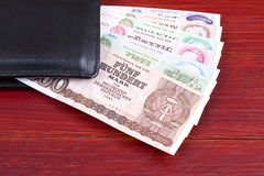 Old money from East Germany in the black wallet Royalty Free Stock Photos