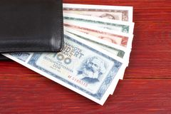 Old money from East Germany in the black wallet Stock Photo