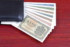 Old money from Germany in the black wallet Royalty Free Stock Photo