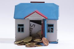 Old moneybox and coins  Royalty Free Stock Images