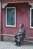 Old mongolian lady. A old lady is waiting for a ceremony in a buddhist temple in mongolia Royalty Free Stock Photography