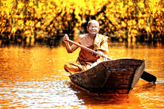 Old monk boating Royalty Free Stock Images