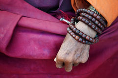 Old monk's hand. Close up old monk's hand with prayer beads Stock Images