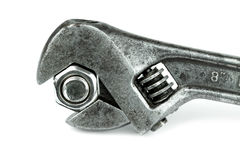 Old monkey wrench and bolt nut. On white background royalty free stock photo