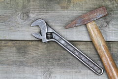 Old monkey wrench and hammer Stock Photos