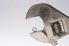 Old monkey wrench and little bolt nut royalty free stock photography