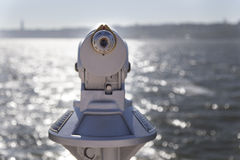 Old monocular telescope on seaside Royalty Free Stock Photos