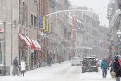 Old Montreal in winter. St-Paul street in Old Montreal in winter snowstorm royalty free stock images