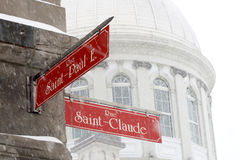 Old Montreal in winter. Street signs in Old Montreal in winter snowstorm Royalty Free Stock Images