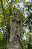 Old monument. Mother of God on the Tomb in Rakowicki cemetary in Krakow Stock Photography