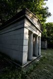 An Old Monument at Mt. Hope Cemetery. A monument is backlit by the late afternoon sun at the the historic Mount Hope Cemetery in Rochester, New York, July 2018 Stock Photo