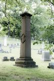 An Old Monument at Mt. Hope Cemetery. A monument is backlit by the late afternoon sun at the the historic Mount Hope Cemetery in Rochester, New York, July 2018 Royalty Free Stock Photo