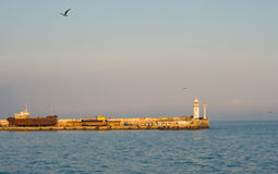 Old moorage with lighthouse Stock Photography
