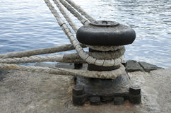 Old mooring bollard in port of Tenerife. Spain Stock Photography