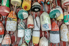 Old mooring buoys. Old and worn out mooring buoys hanged on a wall Stock Image