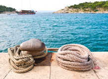 Old mooring rope and bollard Stock Photo