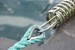 Old mooring rope. Over blue sea backgrond Royalty Free Stock Photo