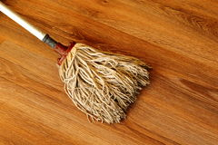 Old mop on wooden parquet Stock Photography