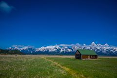 Free Old Mormon Barn In Grand Teton Mountains With Low Clouds. Grand Teton National Park, Wyoming Stock Photos - 118279593