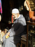 Old moroccan seller in his shop Stock Photography