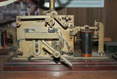 Old morse key telegraph on wooden table stock photo