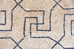 Old mosaic. Old roman mosaic background in a street Stock Photos
