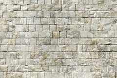 Old mosaic stone wall background texture. Close up Royalty Free Stock Images