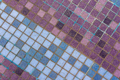 Old mosaic tiles of different shades lined  diagonal Royalty Free Stock Photography