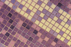 Old mosaic tiles of different shades lined  diagonal Stock Photo
